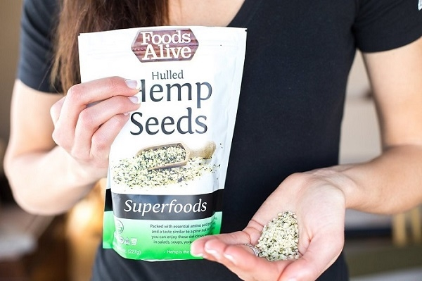 Hulled_Hemp_Seeds_-_Woman_holding_bag_and_pile_of_hemp_seeds_in_hands.jpg