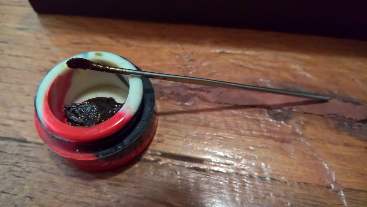 Rosin and tool to scoop into vape coil area.