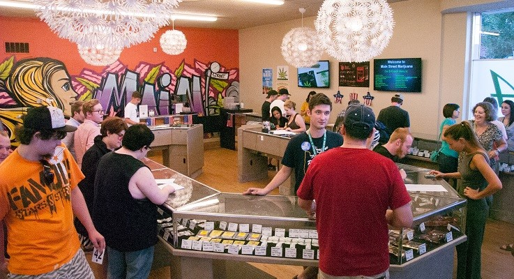 Customers visit Vancouver recreational pot shops New Vansterdam and Main Street Marijuana on Wednesday, July 1, 2015, the day recreational marijuana became legal in Oregon. (Justin Runquist/The Columbian)