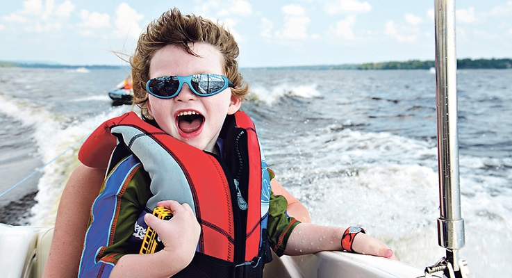 Liam McKnight takes his first-ever boat ride recently. The Ottawa boy, whose mother is from Torbay, has Dravet Syndrome, a severe form of epilepsy that can cause him to have as many as 70 seizures a day. Medicinal marijuana is enabling him to enjoy things like boat rides. Photo by Tracey Haycox