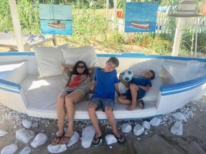 April Pride, Founder of Van der Pop, relaxes with her two sons